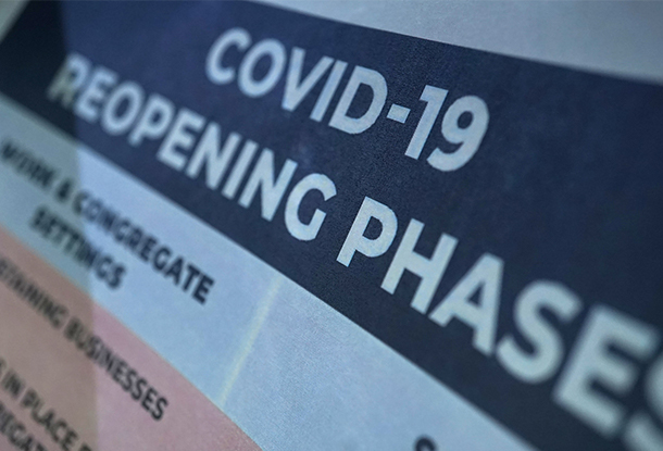 """photo: document with title """"COVID-19 reopening phases"""" (iStockphoto)"""