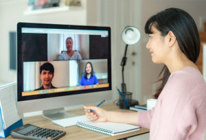 photo: woman on video call with colleagues (iStockphoto)