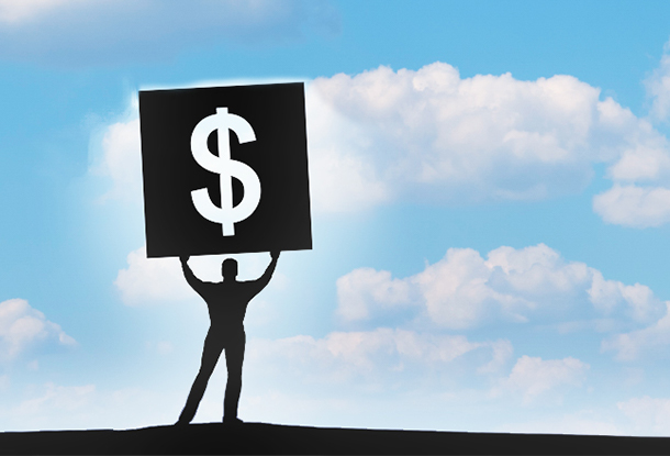 photo: figure holds large dollar sign to the sky (iStockphoto)