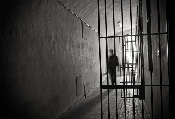 photo: shadow figure with prison bars (iStockphoto)