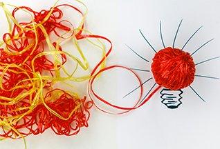 Intertwined strings make lightbulb (iStockphoto)