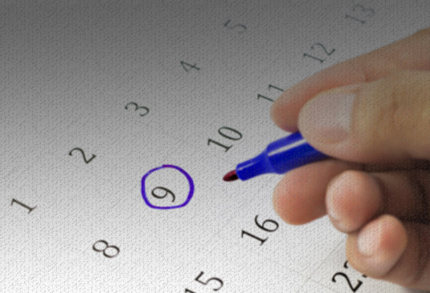 Circling date on calendar (iStockphoto)