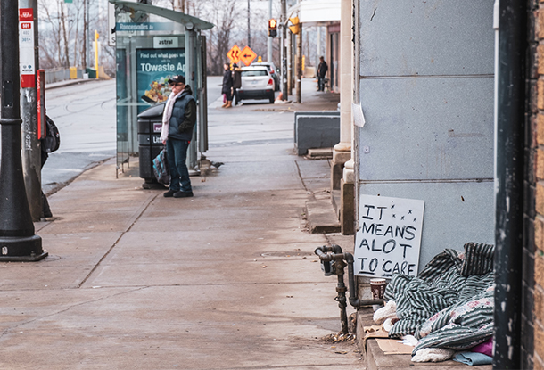 photo: Homeless Person with Sign, Queen St., Toronto (iStockphoto)