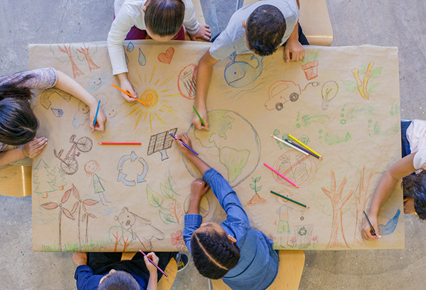 photo: children drawing together on a table
