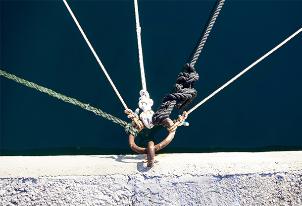 Knotted ropes tethered to a metal hoop (iStockphoto)