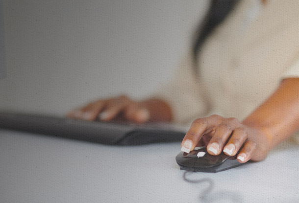 Hand on computer mouse (iStockphoto)