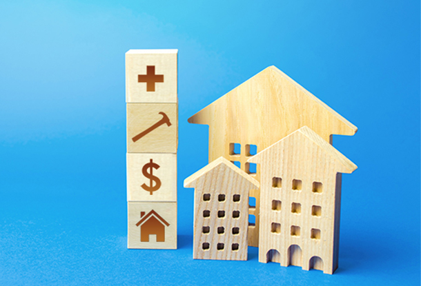photo: blocks with icons next to small wooden houses (iStockphoto)