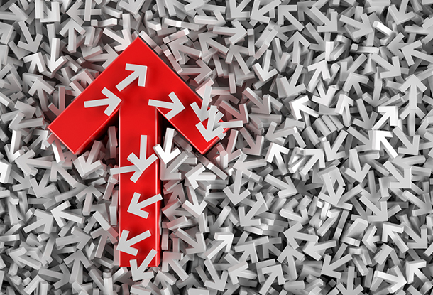 image: Red Arrow Moving Up on White Arrows (iStockphoto)