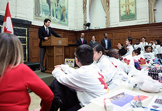 PM Justin Trudeau speaks to the children